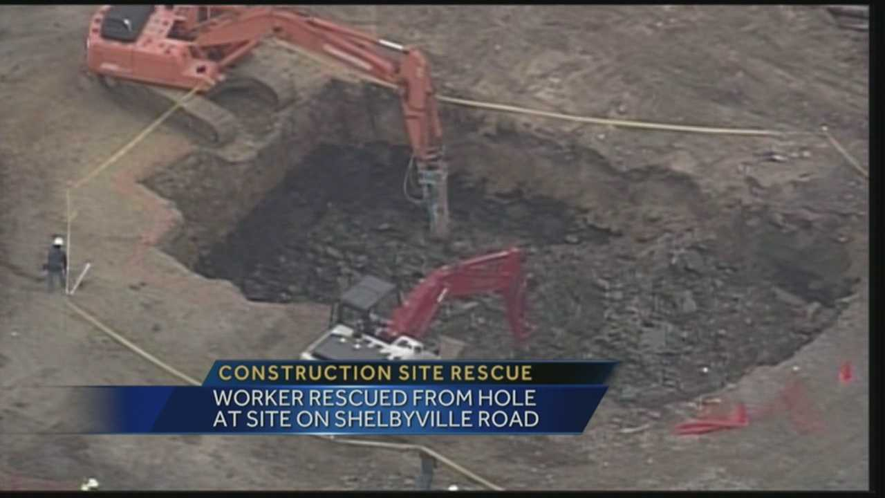 Worker rescued after falling into hole at work site