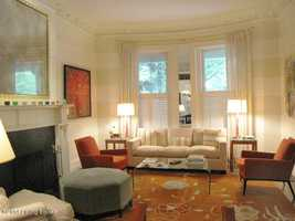 The comfortable, living room is not only sophisticated, but hints at the home's antique era.
