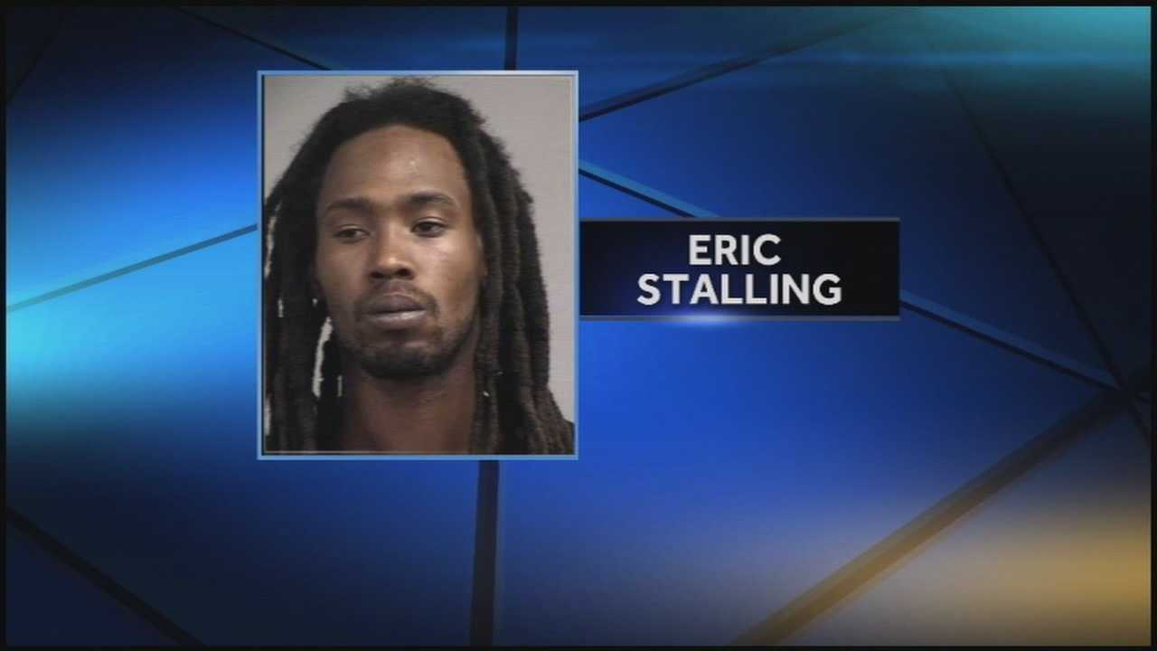 Louisville Metro Police arrest a man in connection with a 2011 hotel robbery.