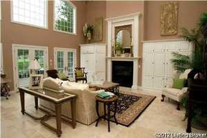 Formal living room with 2-story coffered ceilings.