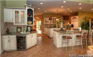 The kitchen also includes a wine cooler.