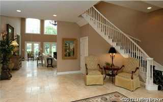 Foyer welcome you to a tiled-open floor plan.