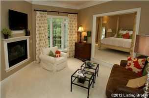 Master bedroom also has a private outdoor balcony and sitting area.