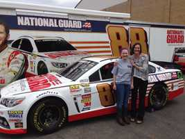 Sondra Miller and Kaelin Trayner (daughter) with show car. Miller won the visit for the school through the Race 2 Achieve program.