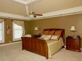 Master bedroom features beautiful ceiling.