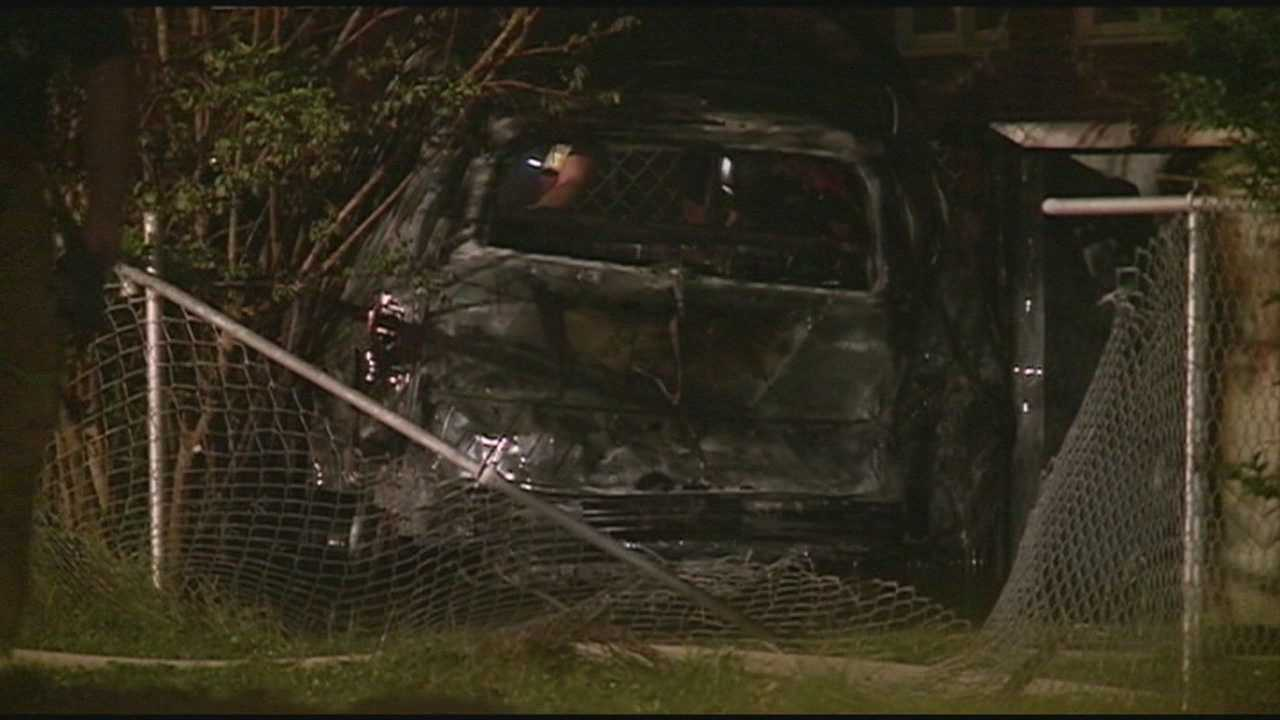 A stolen vehicle crashed through a fence and into an above ground pool early Friday morning and burst into flames.