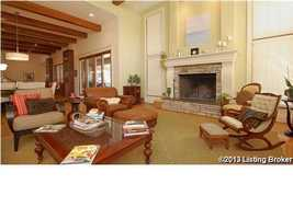 The living room boasts a fireplace with a natural tone brick fireplace.