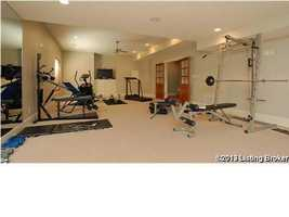 Recessed lighting and workout equipment in the home gym.