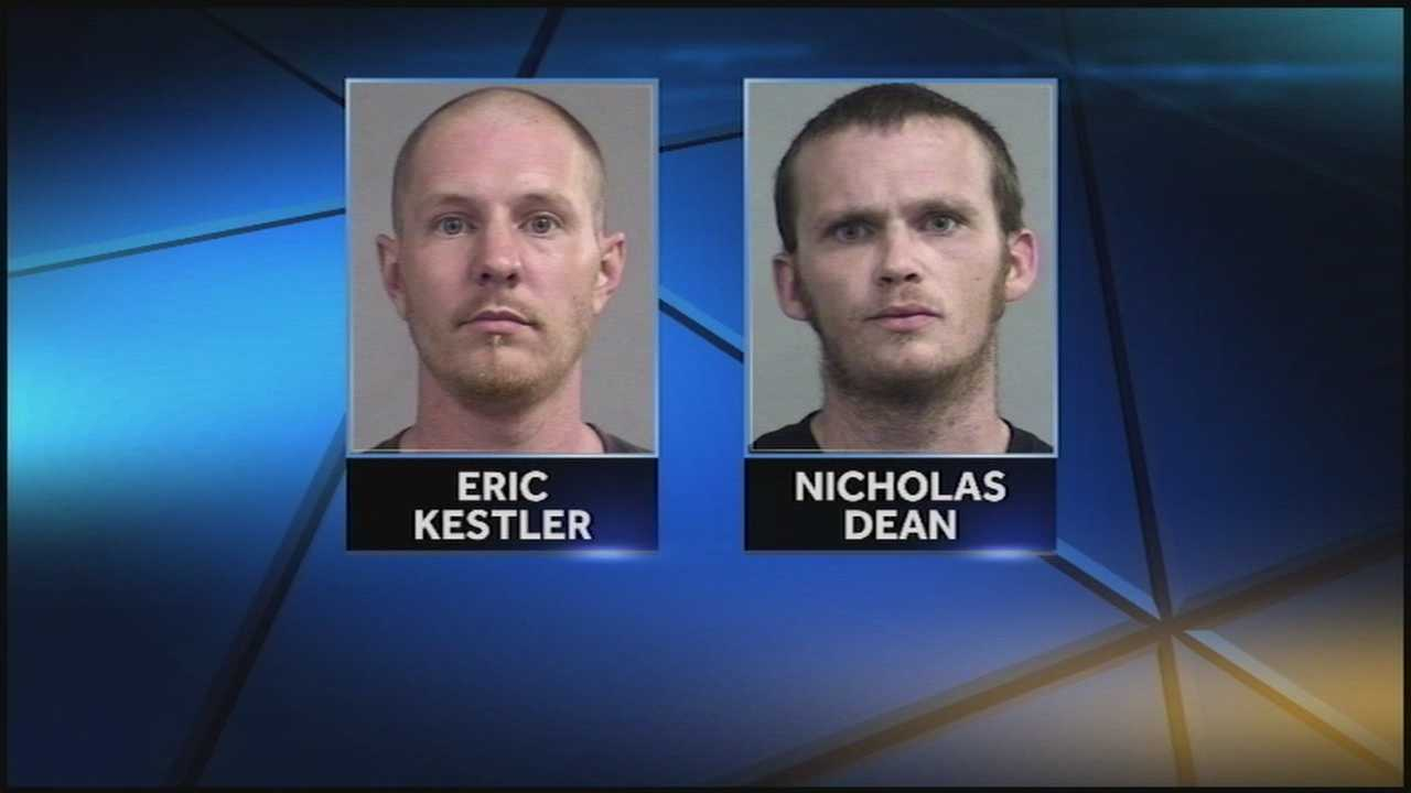 Two men are arrested after police say surveillance video shows them breaking into an area home.