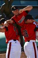 The University of Louisville baseball team poses for team photos outside Ameritrade Park in Omaha ahead of the 2014 College World Series.