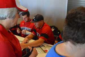 Louisville baseball players sign autographs for fans ahead of their appearance at the College World Series in Omaha.