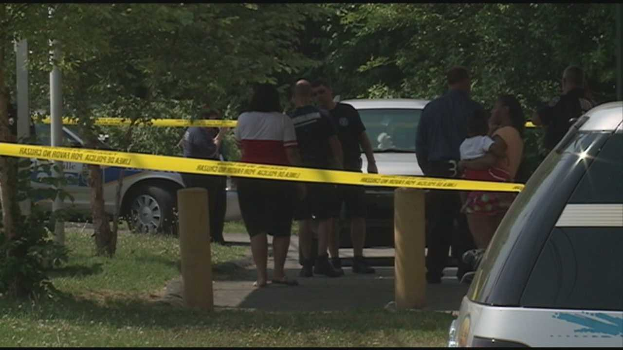 Police searching for gunman after woman is shot in front of child