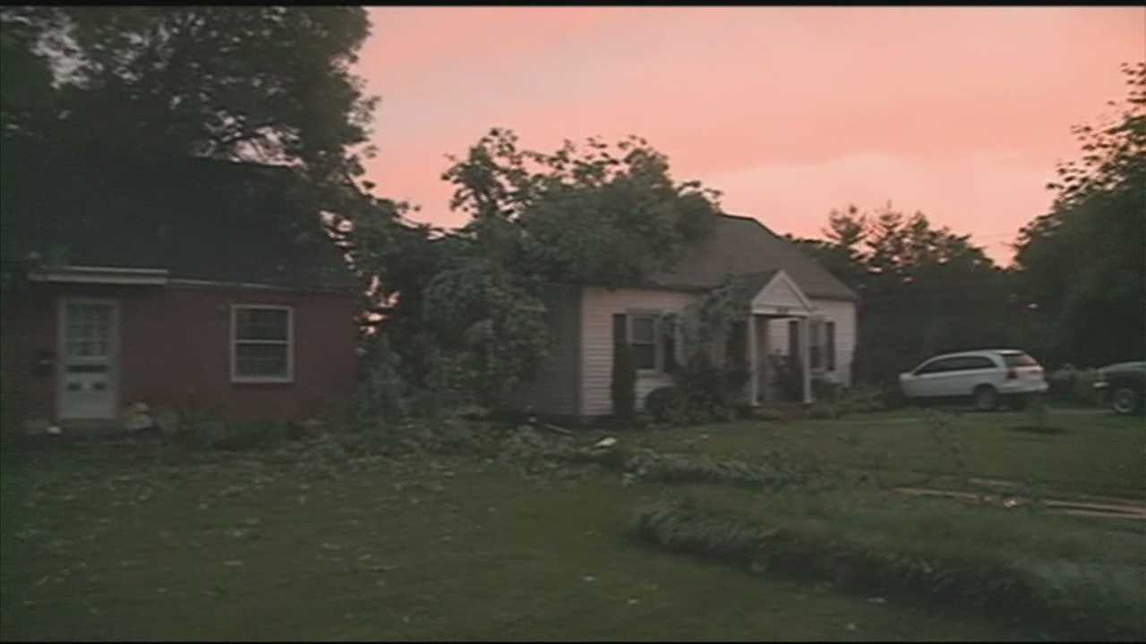 A fast-moving line of thunderstorms caused damage at several homes and left thousands of people in the dark.