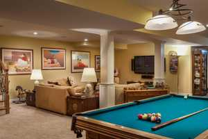 The basement is complete with a pool table.