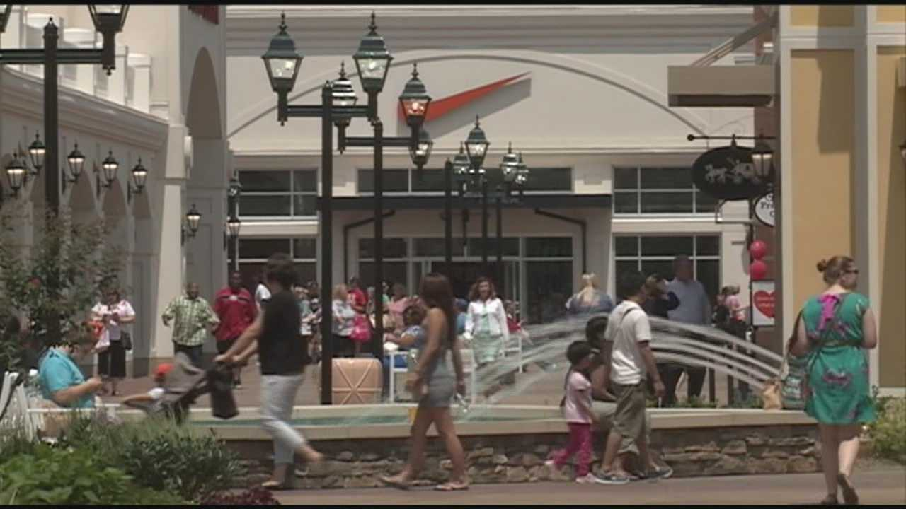 Residents adjusting to opening of new outlet mall