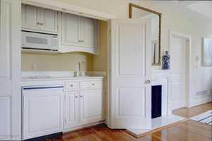 The master suite includes a full service kitchenette including microwave, stove top, dishwasher and sink.
