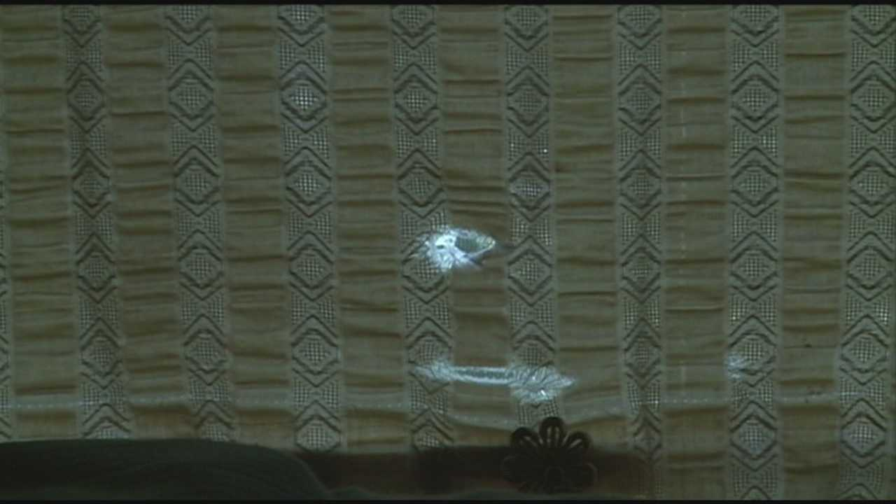 A bullet flew through a southern Indiana home, striking a woman in the stomach early Tuesday morning.