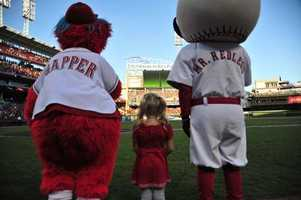 Some think Reds opening day should be a Cincinnati holiday. Just ask Mr. Redlegs and Gapper.