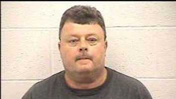Kerry Prater, accused of running a roadblock with three guns in the car. More info here.