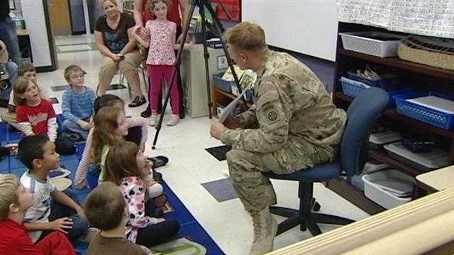 A soldier surprises a local elementary school.