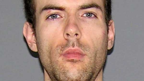 Scott Johnson, accused of attacking his roommate with a sword.