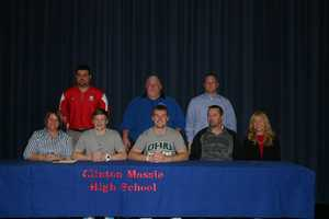 Clinton-Massie's Wyatt Running and Trent Smart signed their National Letters of Intent to play football for Notre Dame College and Ohio University.
