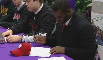 Elder's AJ Burdine signs his letter of intent to play football for Miami University.