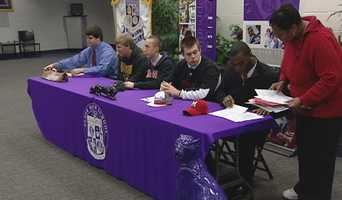Five high school athletes sign their National Letters of Intent to play college athletics at Elder.
