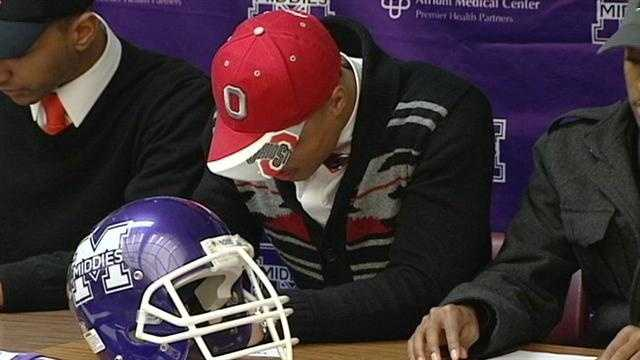 Middletown quarterback Jalin Marshall signs his letter of intent to play college football for Ohio State University.