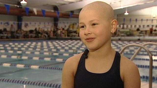 An 8-year-old girl is standing tall in the face of cancer and still racing to be a champion.
