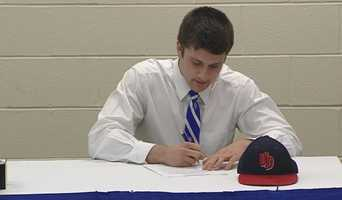 CovCath quarterback Blake Bir signs his letter of intent to play college football for the University of Dayton.