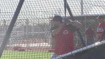 Joey Votto takes batting practice.