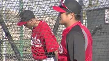 Choo looks on as a teammate takes batting practice.