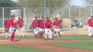 Reds practice fielding the ball.