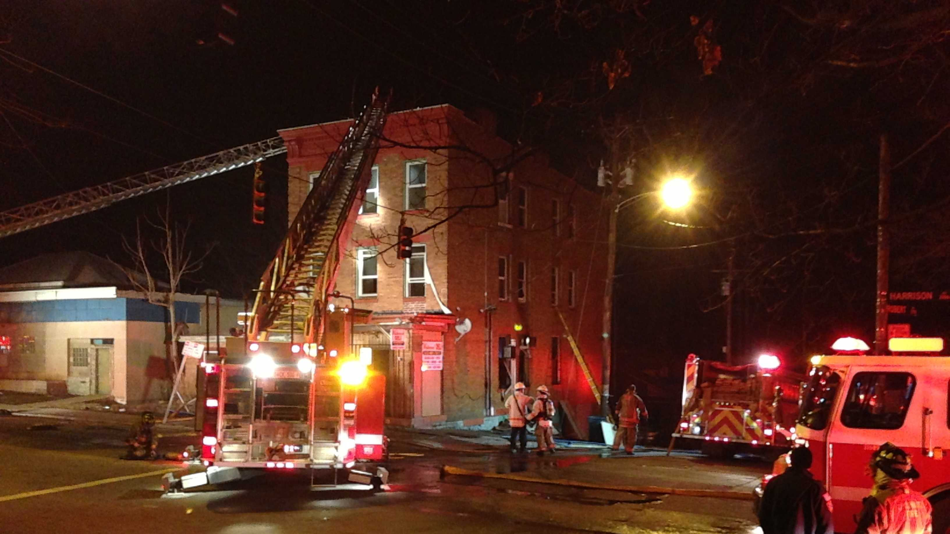 A woman told firefighters that she broke her leg after jumping from a window to escape a 2-alarm fire in Westwood.