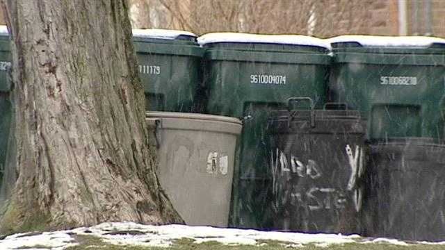 Garbage cans by tree