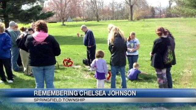 The family of a slain teenager holds a graveside vigil to mark a year since she was murdered.