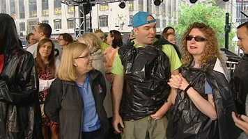 Teams had 60 seconds to see how many fish they could pass down a 50-foot court on Fountain Square on Friday.