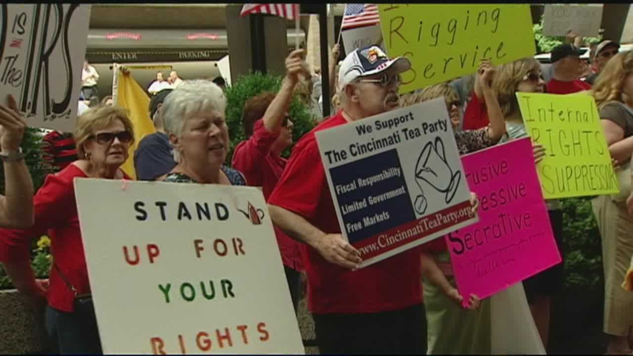 """Chanting """"IRS has got to go,"""" tea party activists rallied in Cincinnati to protest extra scrutiny of their groups."""