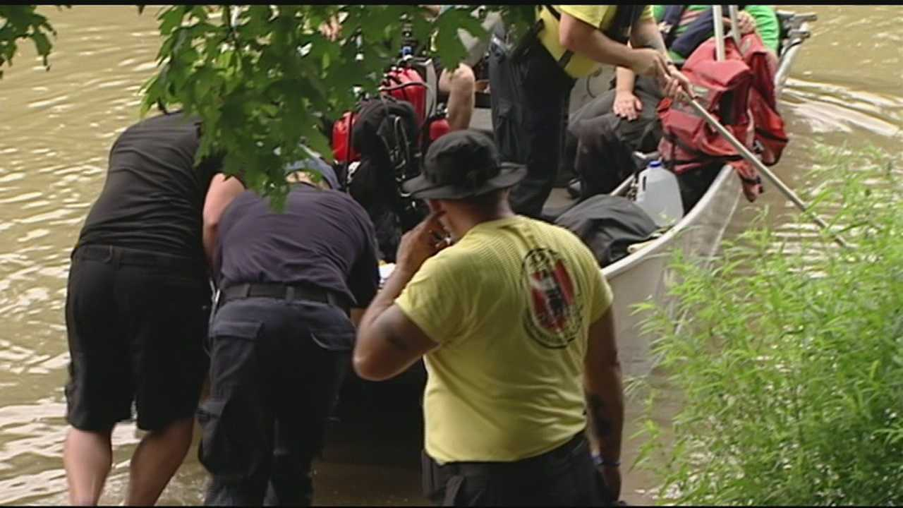 Crews return to river in search of missing swimmer