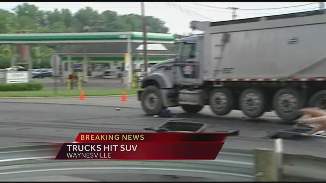 SUV hit by semi-truck, knocked into path of dump truck