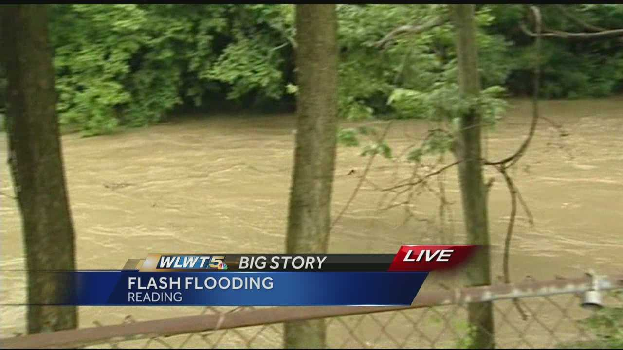 Residents watch Mill Creek leave its banks