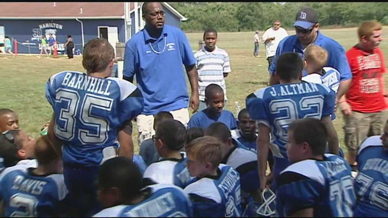Peewee football team remembers slain coach at first home game