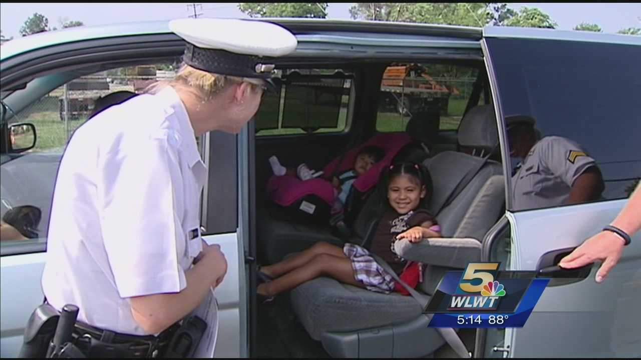 Police check cars to make sure kids properly restrained