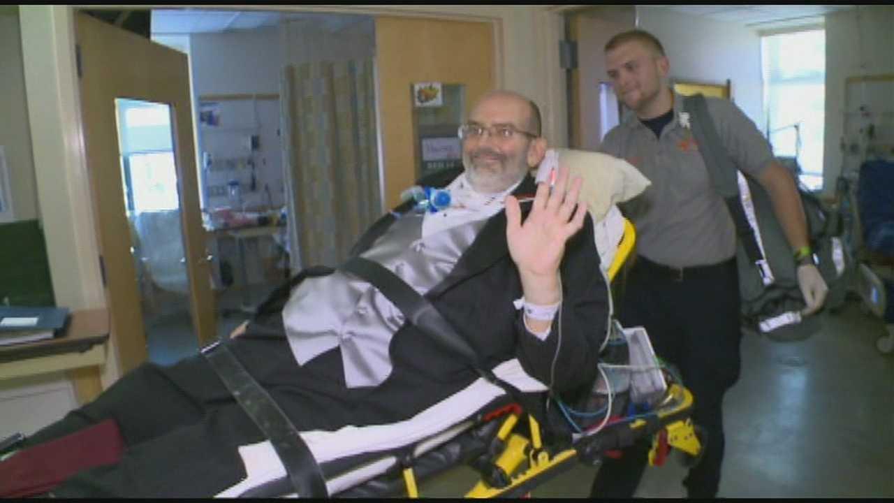Volunteer team of medical professionals help Scott Nagy escort daughter down aisle