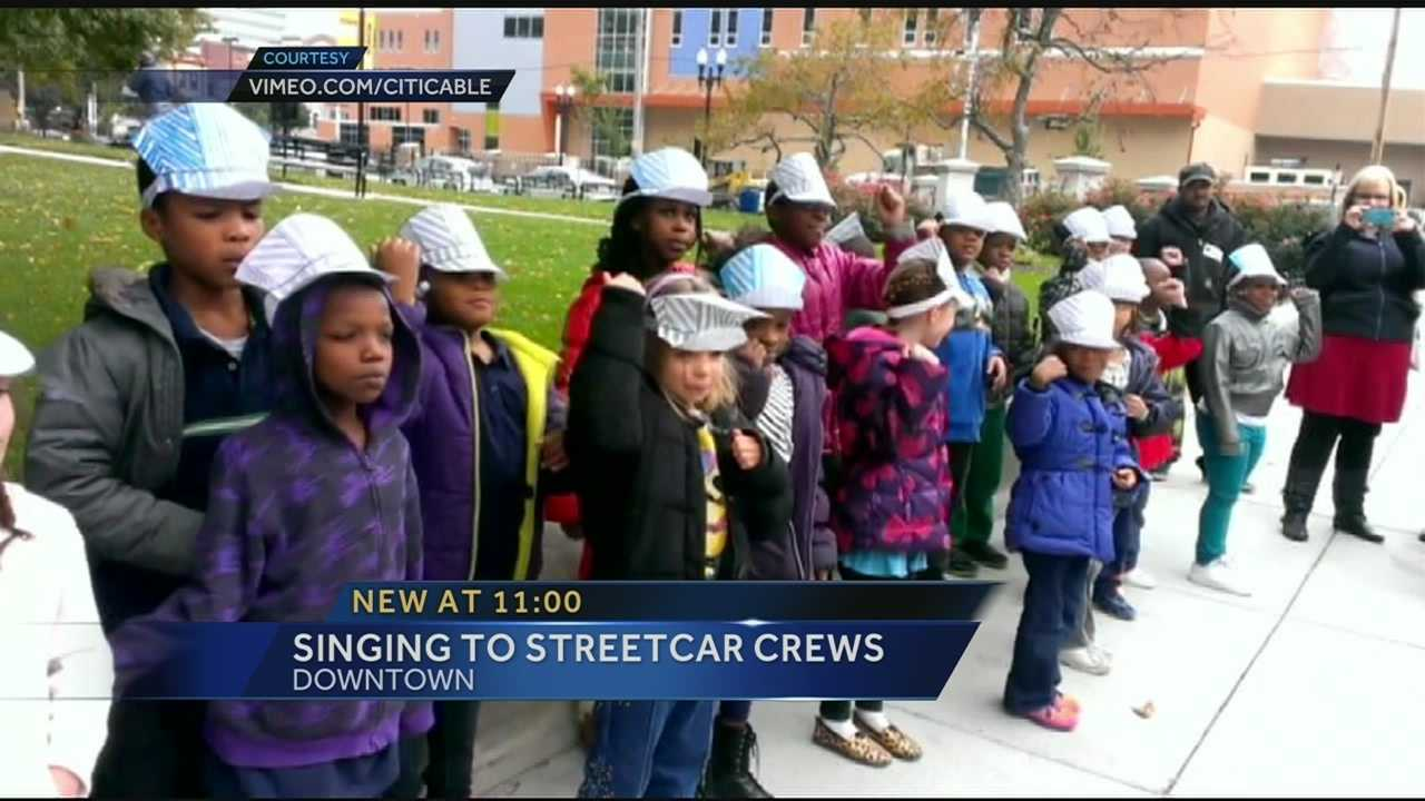 The children are second graders at The School for Creative & Performing Arts and with the help of their teacher, they stopped by the streetcar construction site Thursday and what a great song choice.