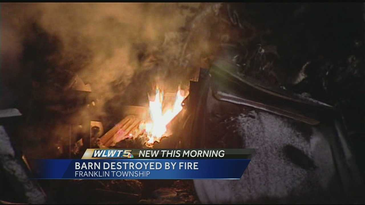 The barn, several vehicles and some farm equipment were all destroyed by the overnight fire.