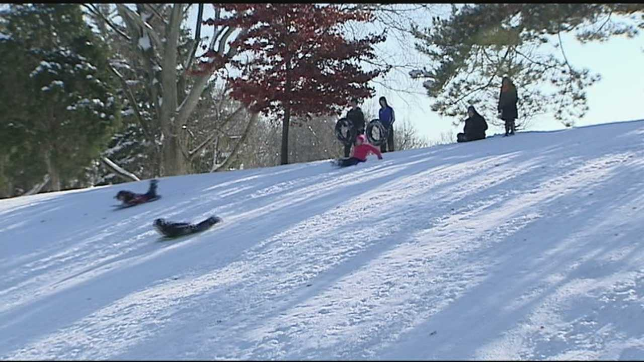 Whether they're kids, grandkids, or kids at heart, all over town they headed for the hills, slipping and slidding down.