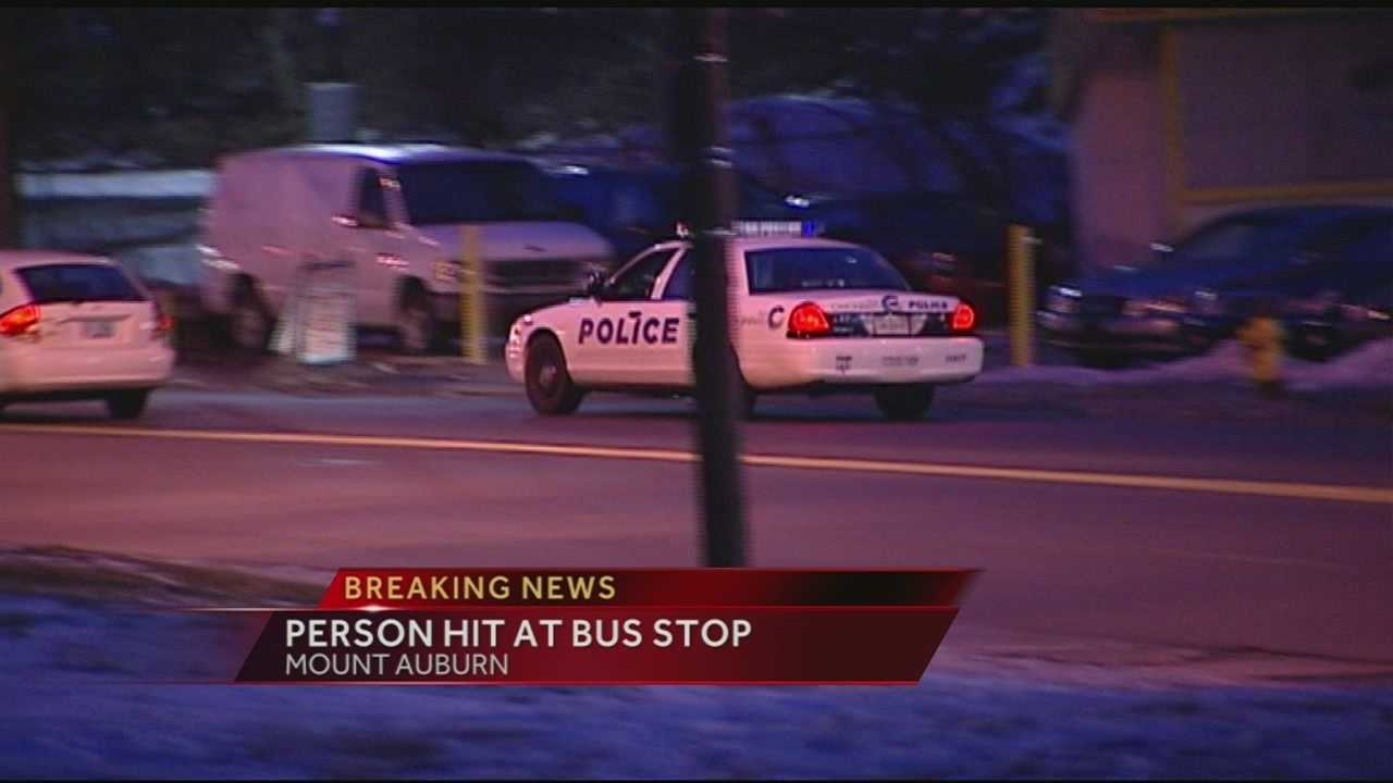 Woman hit by car while waiting for bus