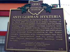 This Ohio historical marker stands near Findlay Market at Glass Alley and Pleasant Street.